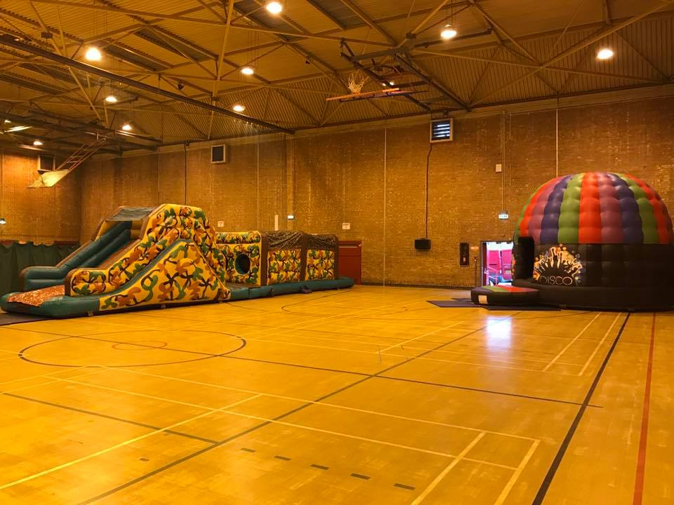 This image shows one of our disco party pods and inflatable assault courses on hire in St Helens